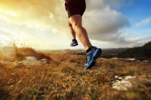 Outdoor cross-country running in early sunrise concept for exerc